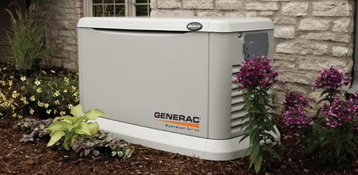 Standby generator in yard next to house.