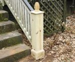 Newel post on porch with newly replaced facing boards, cap, and finial.