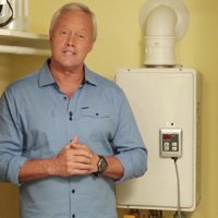 Danny Lipford with tankless hot water heater.