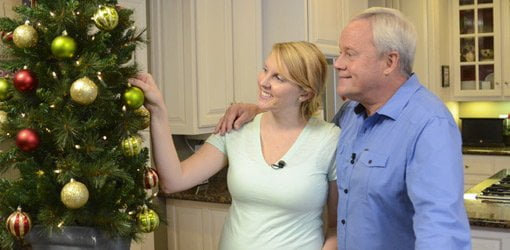 Danny Lipford with daughter Chelsea Lipford Wolf looking at Christmas tree.