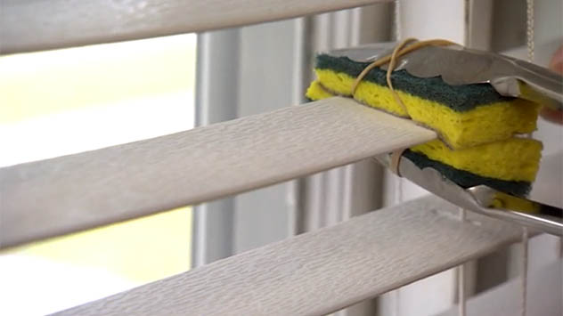 cleaning blinds with tongs and sponges