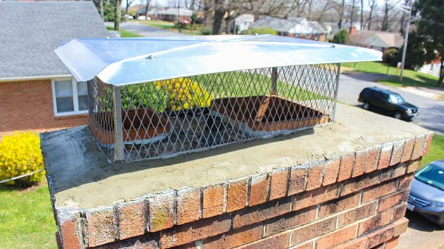The chimney cap fits over the flues and is secured to the crown of the chimney.