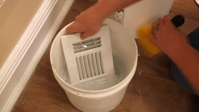 cleaning heating and cooling register with soapy water
