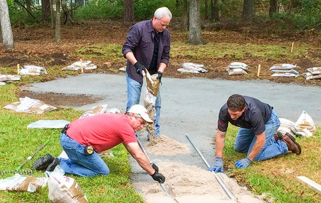 Laying a paver patio in backyard
