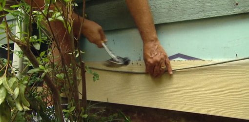 Replacing bottom boards with fiber cement siding.