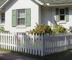 White picket fence around cottage.