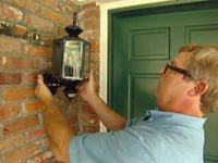 Replacing house entry light fixture.