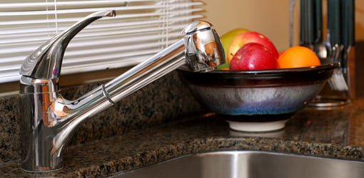 Chrome kitchen sink faucet.