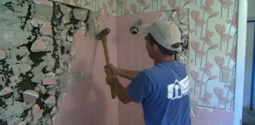 Pink bathroom wall tile demolition.