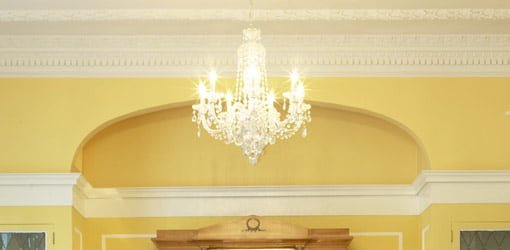 Crown and picture molding on yellow wall.