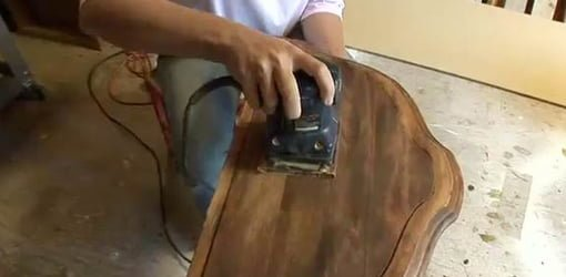 Sanding table top.