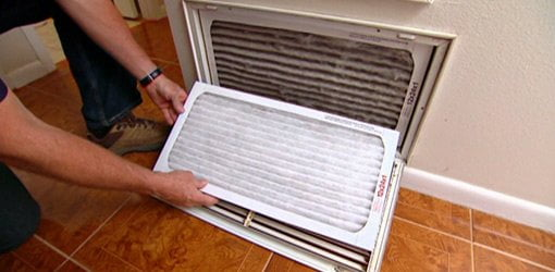 Replacing a return air filter.