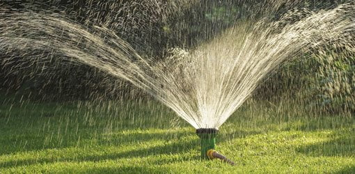 How to irrigate your home todays homeowner sprinkler watering lawn solutioingenieria Gallery