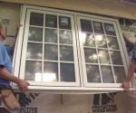 Installing casement window units on master bedroom addition.
