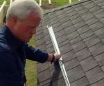 Danny Lipford installing a rain diverter on a roof.