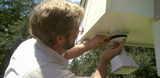 Installing a motion sensor outdoor security light. - How To Install An Outdoor Security Light Today's Homeowner