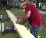 Using a circular saw to cut fiber cement siding.