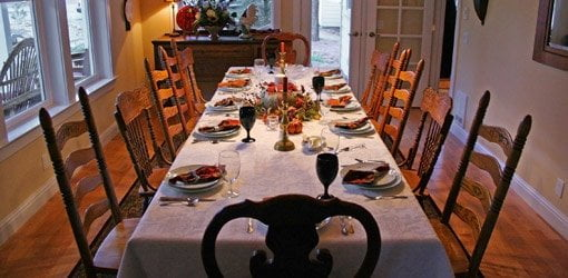 Dining table set for Thanksgiving dinner.