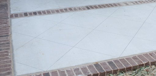 Patio floor after cleaning and scoring lines in concrete.