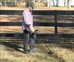 Using metal detector to find iron pins for property line