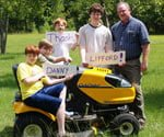 Cub Cadet contest winners with lawn tractor.