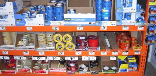 Rolls of different tape on shelves at home center.