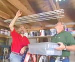 Joe and Danny installing overhead shelving