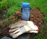 Water jug and work gloves.