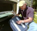 joe securing items in trunk of car