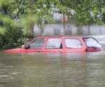 Car underwater in flood.