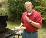 Danny grilling meat