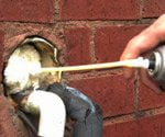 filling cracks with caulk
