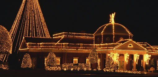 Home outlined in Christmas lights