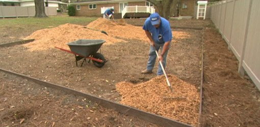 Adding Wood Mulch To Play Area.