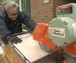 Danny Lipford using a wet saw to cut tile.