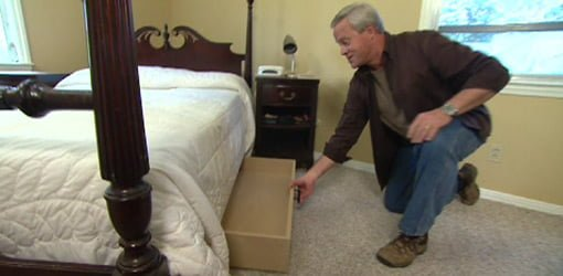 Danny Lipford pulling out under bed storage drawer