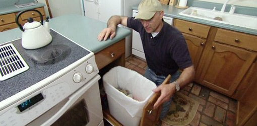 Joe Truini With Homemade Pullout Kitchen Trash Can.
