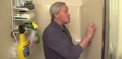 Danny Lipford demonstrating how to clean a shower.