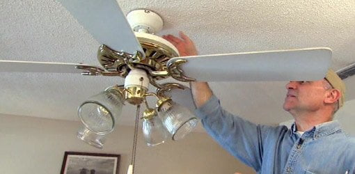 Joe Truini fixing an out of balance paddle ceiling fan.