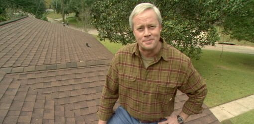 Danny Lipford standing on roof.