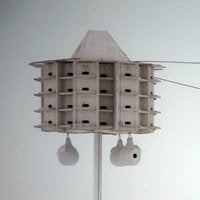 Purple martin house with gourds hangind under it