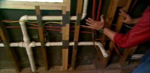 wiring and piping inside a wall