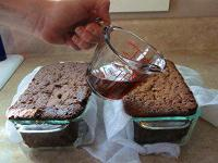 Pouring spirits over fuitcakes to preserve them