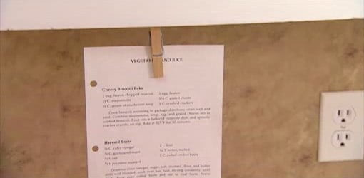 Recipe being held by cabinet recipe holder