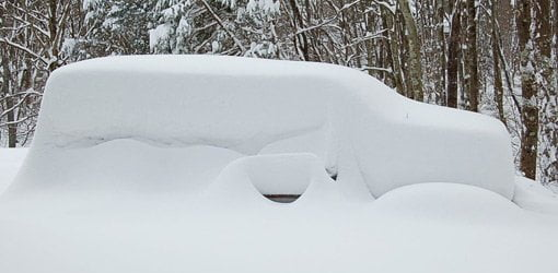 Pickup truck buried in snow