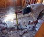 Breaking up concrete poured between joists in bathroom floor