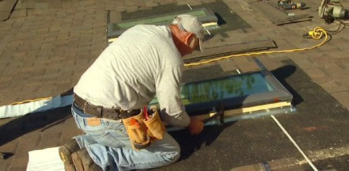No leak skylight being installed on roof of Kuppersmith Project house