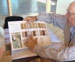 Designer Joe Boehm, of Better Homes & Gardens magazine, going over the cabinet design.