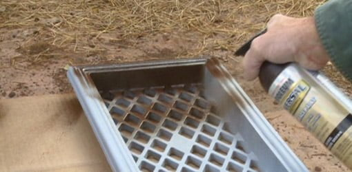 Spray painting a cast iron foundation vent grate