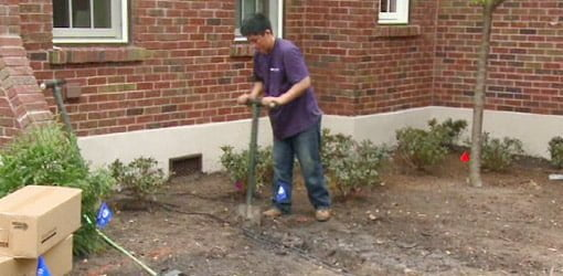 Digging trenches for landscape lighting wiring